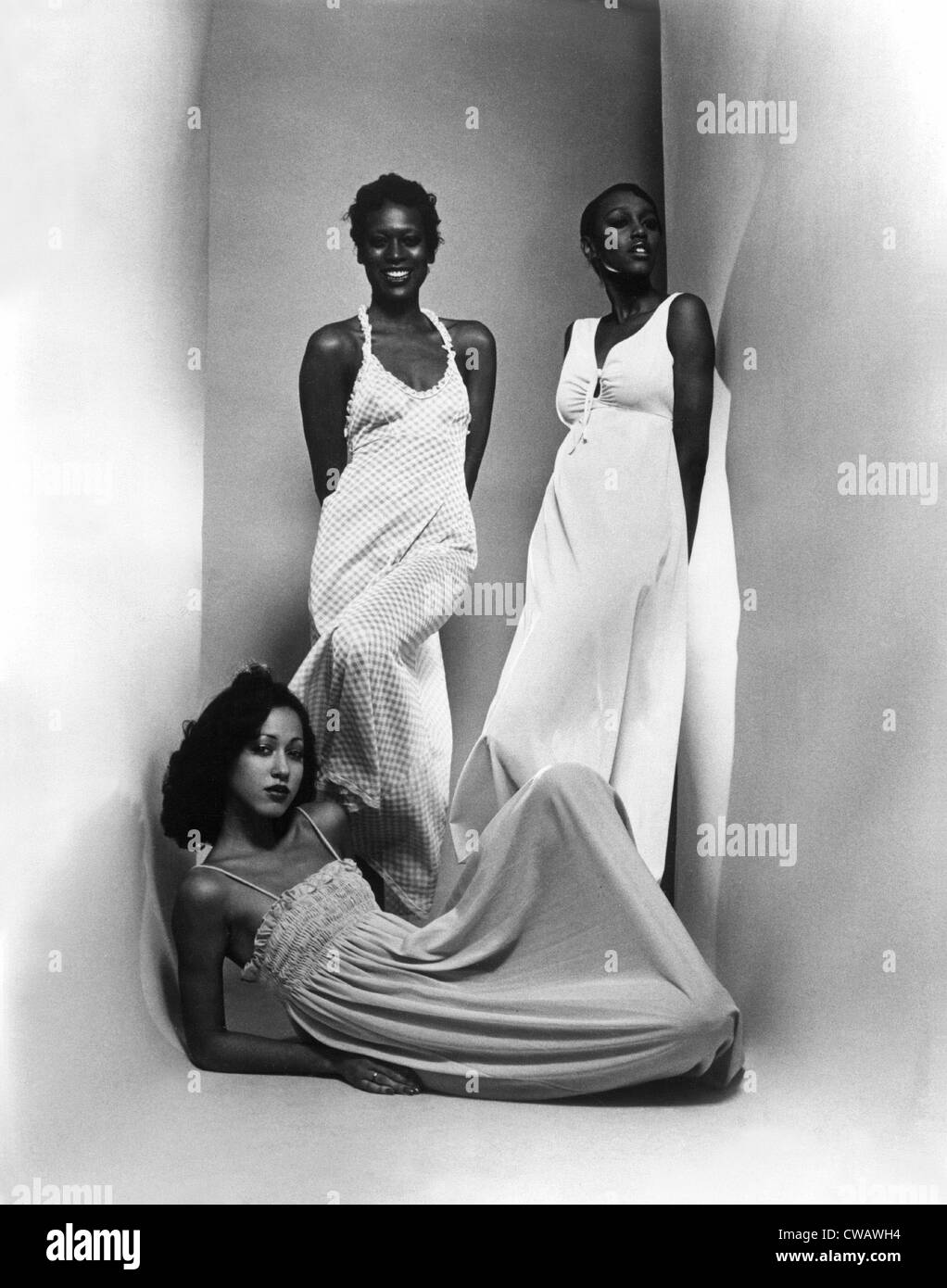 Three models sport maxi-dresses with empire waistlines, 1973.. Courtesy: CSU Archives / Everett Collection - Stock Image