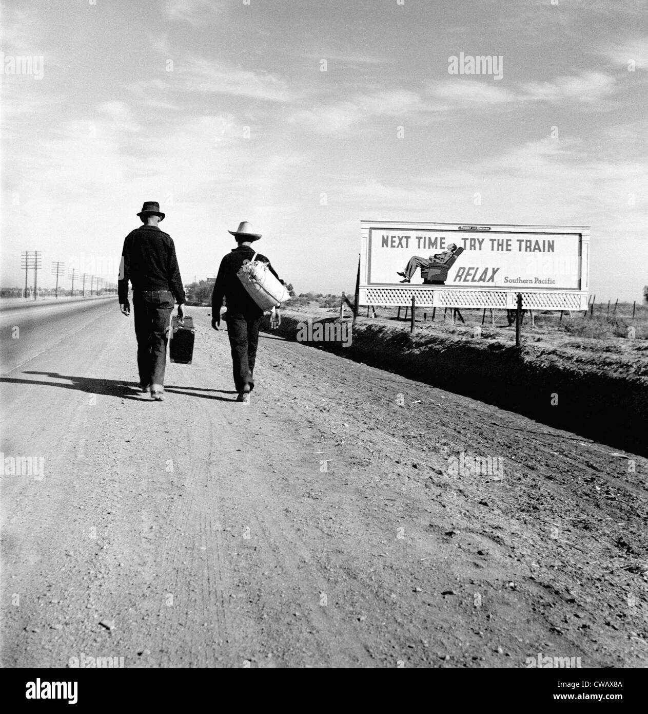 The Great Depression. Toward Los Angeles, California, billboard reads: 'Next time try the train Relax Southern - Stock Image