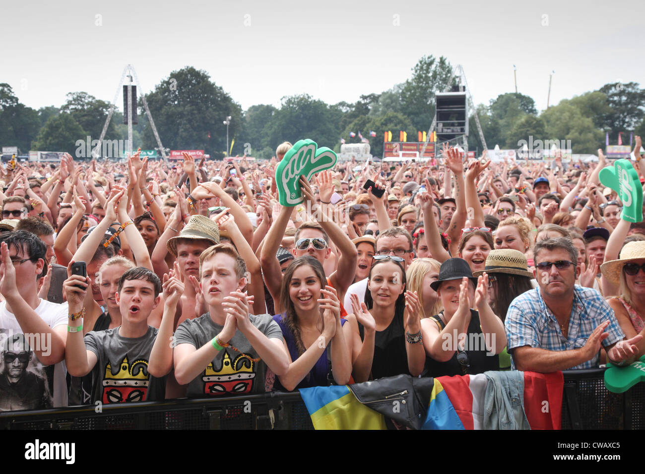 The crowd enjoying the live music at V Festival in Hylands Park, Chelmsford, Essex - Stock Image