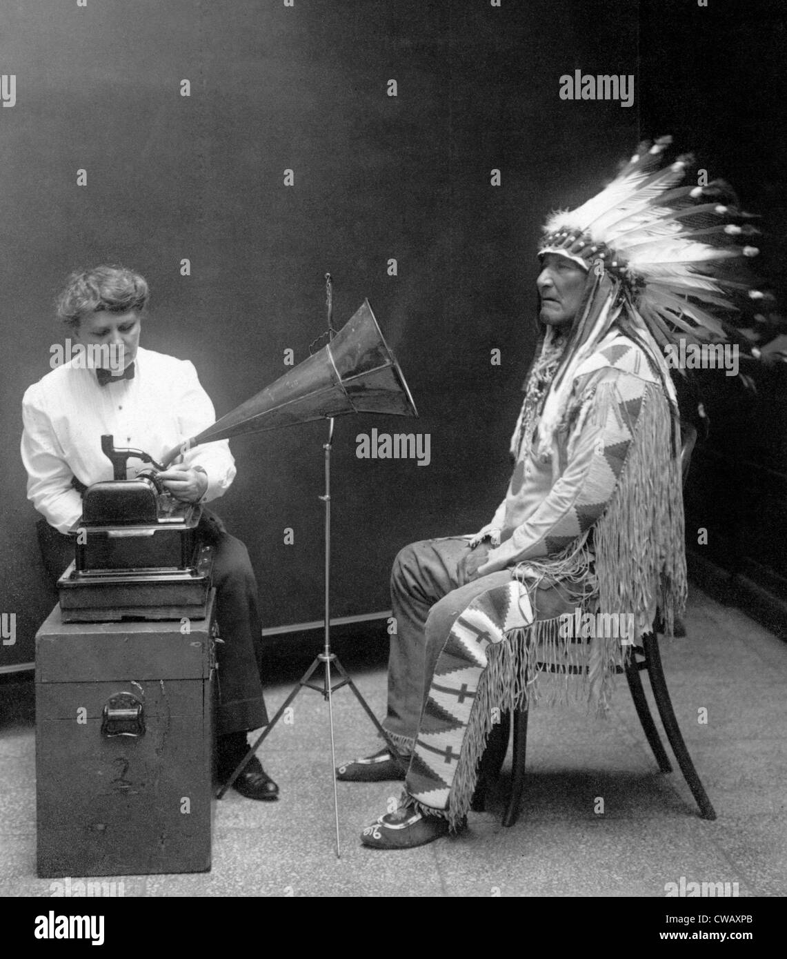 Native American having his voice recorded. Original caption reads: 'Piegan Indian, Mountain Chief, having his - Stock Image