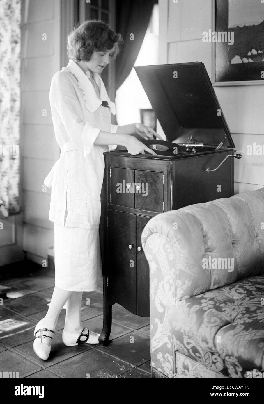 Woman playing a record, circa 1930s. - Stock Image