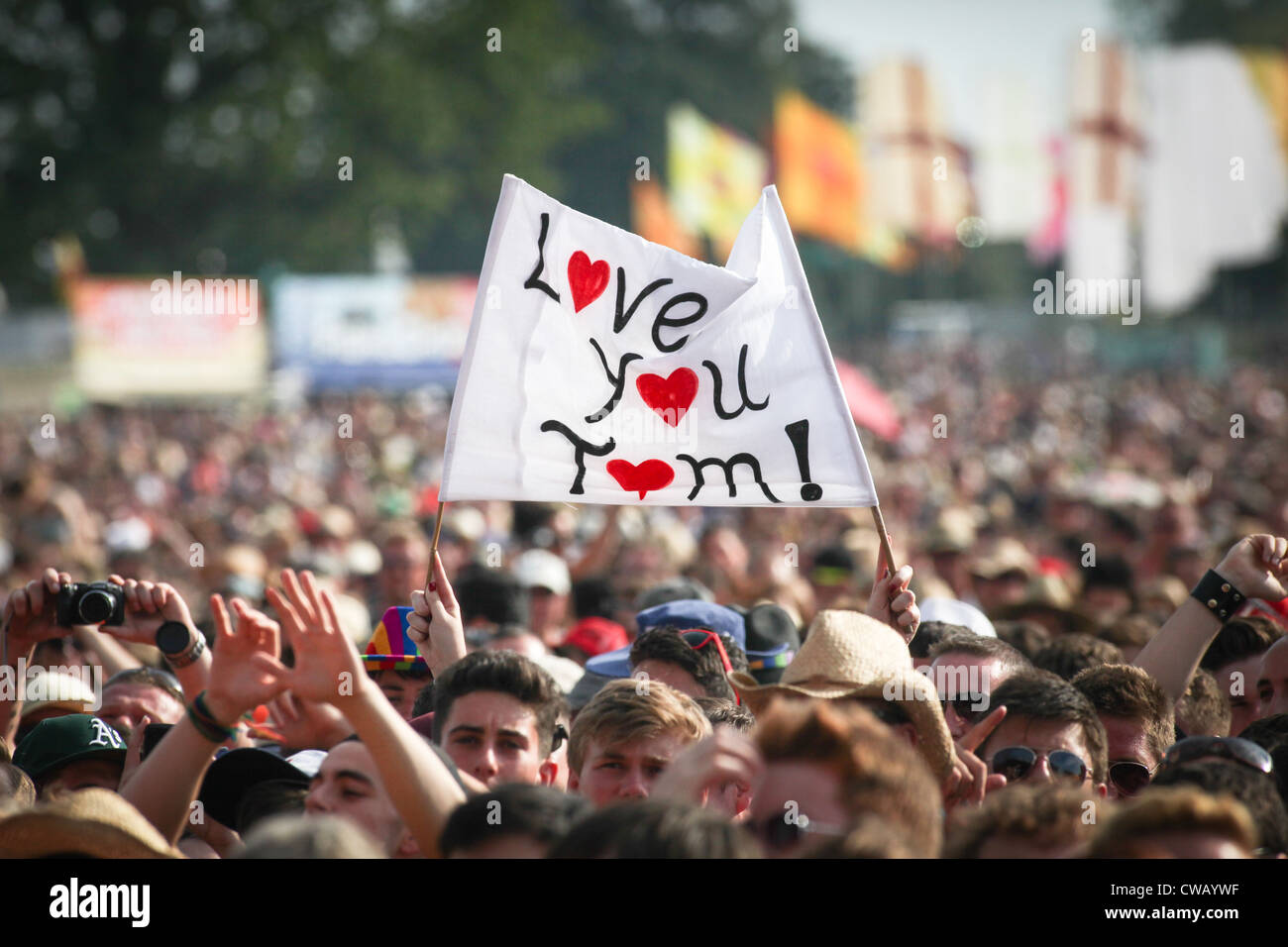A notice in the crowd for Tom Jones at V Festival in Hylands Park, Chelmsford, Essex. The notice reads Love You - Stock Image