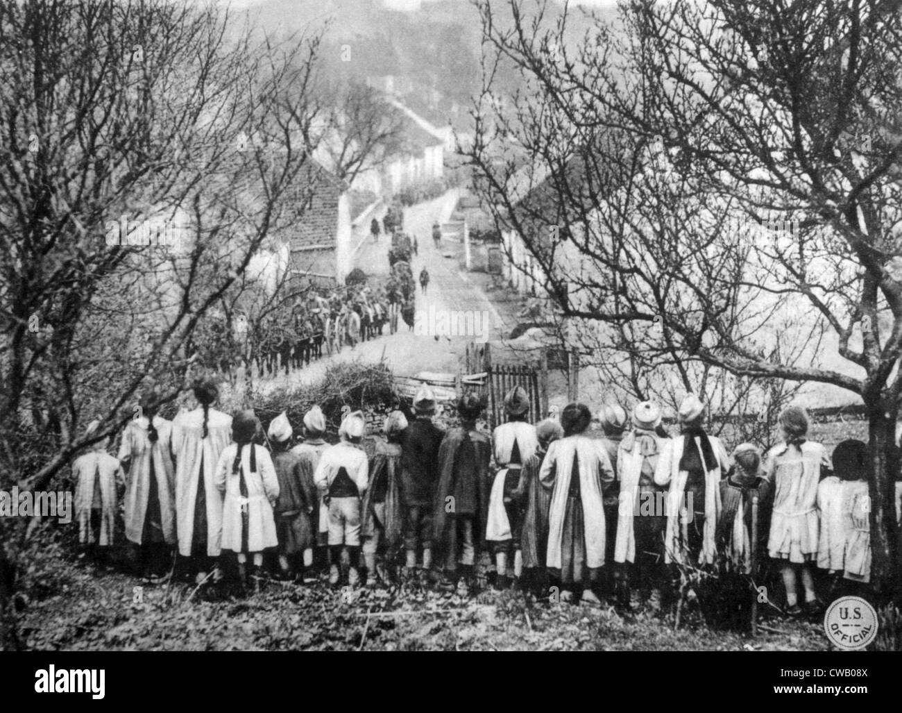 World War I, French children observe the arrival of the American 101st Ammunition Train, U.S. Signal Corps photograph, - Stock Image