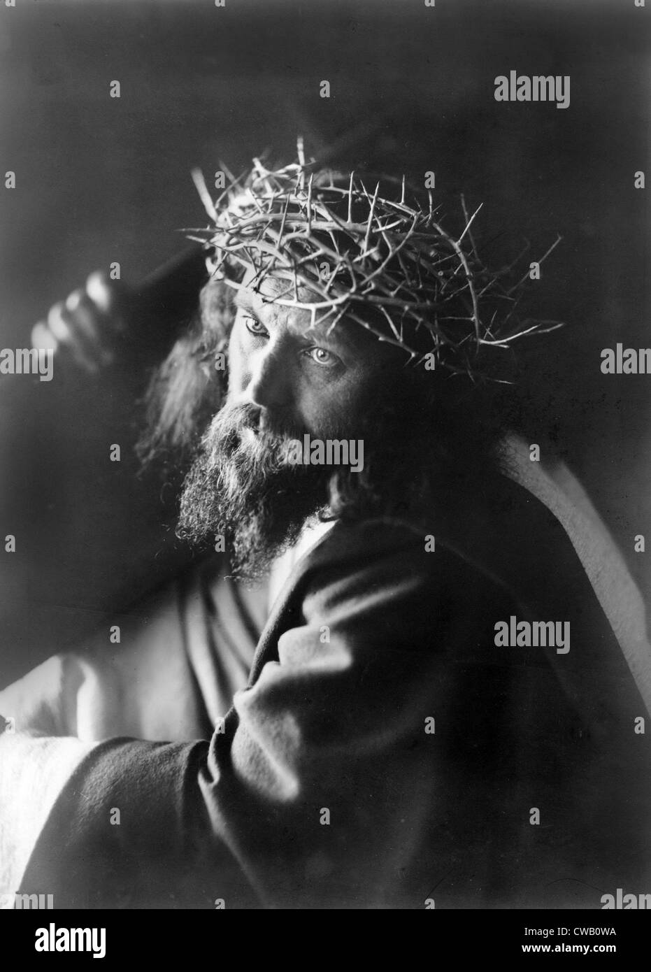 Jesus Christ Man Personifying Wearing Crown Of Thorns And Carrying Cross