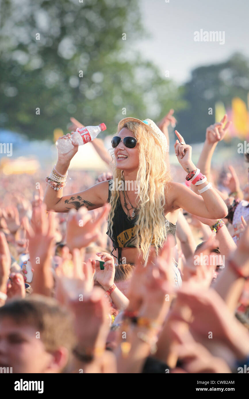 A girl in the crowd enjoying the live music at V Festival in Hylands Park, Chelmsford, Essex - Stock Image