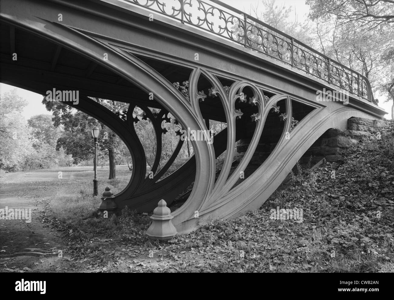 New York City, Central Park's Gothic Arch, view from bridlepath looking northeast showing detail of cast-iron - Stock Image