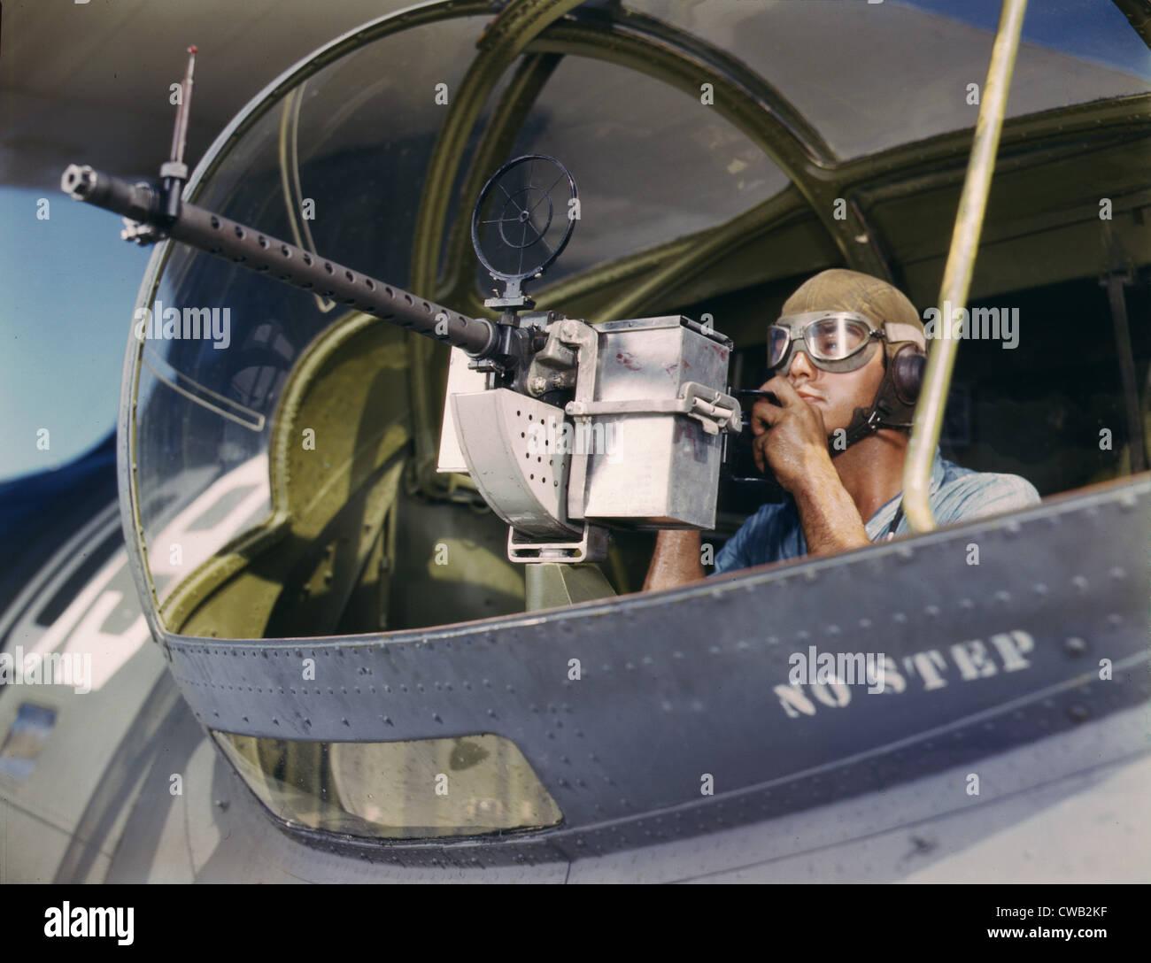 World War II, Jesse Rhodes Waller, A.O.M. third class, tries out a 30-calibre machine gun he has just installed - Stock Image