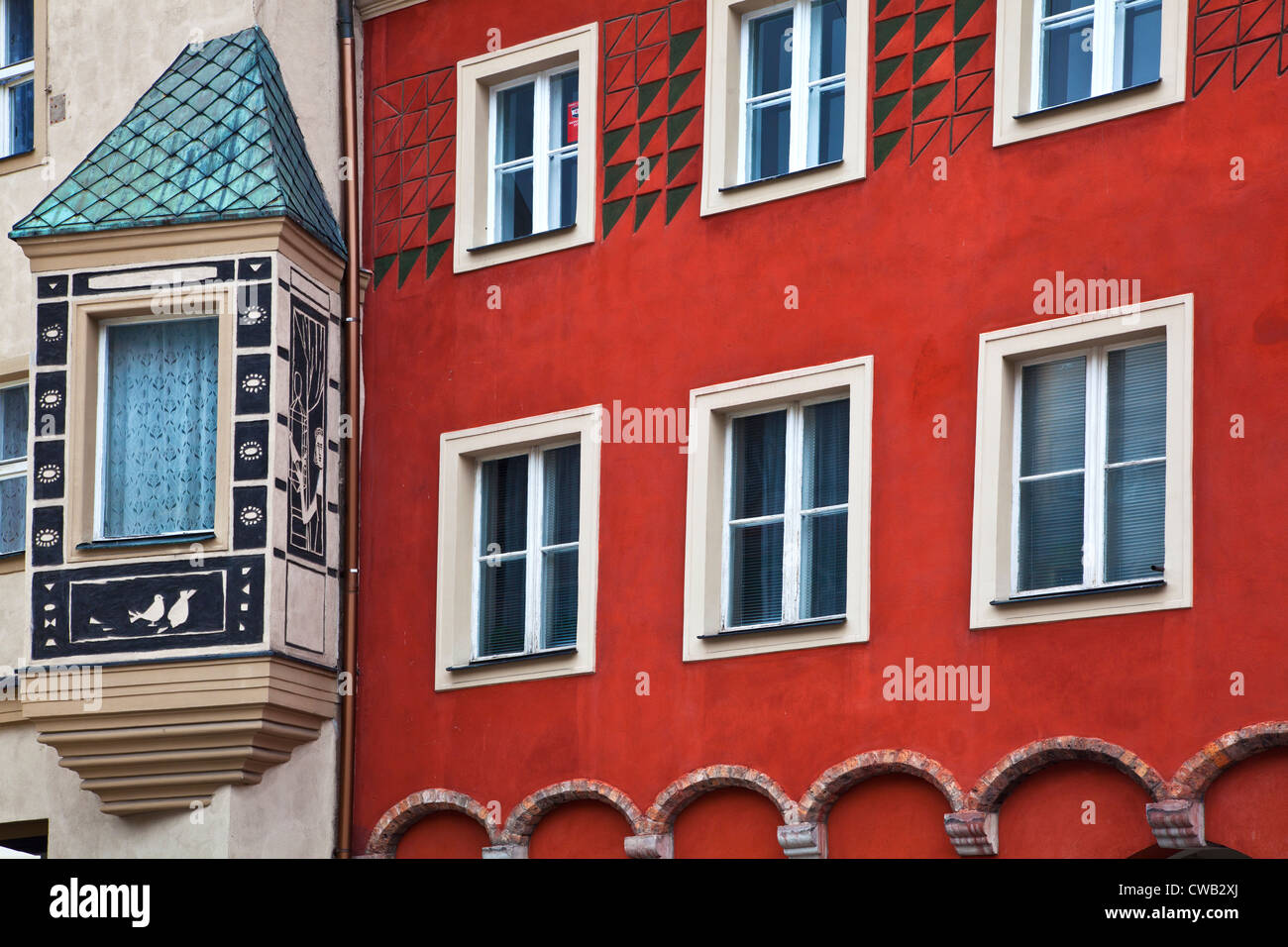 Oriel or bay window and painted decorated house facade in old town market square, Stary Rynek, in Polish city of - Stock Image