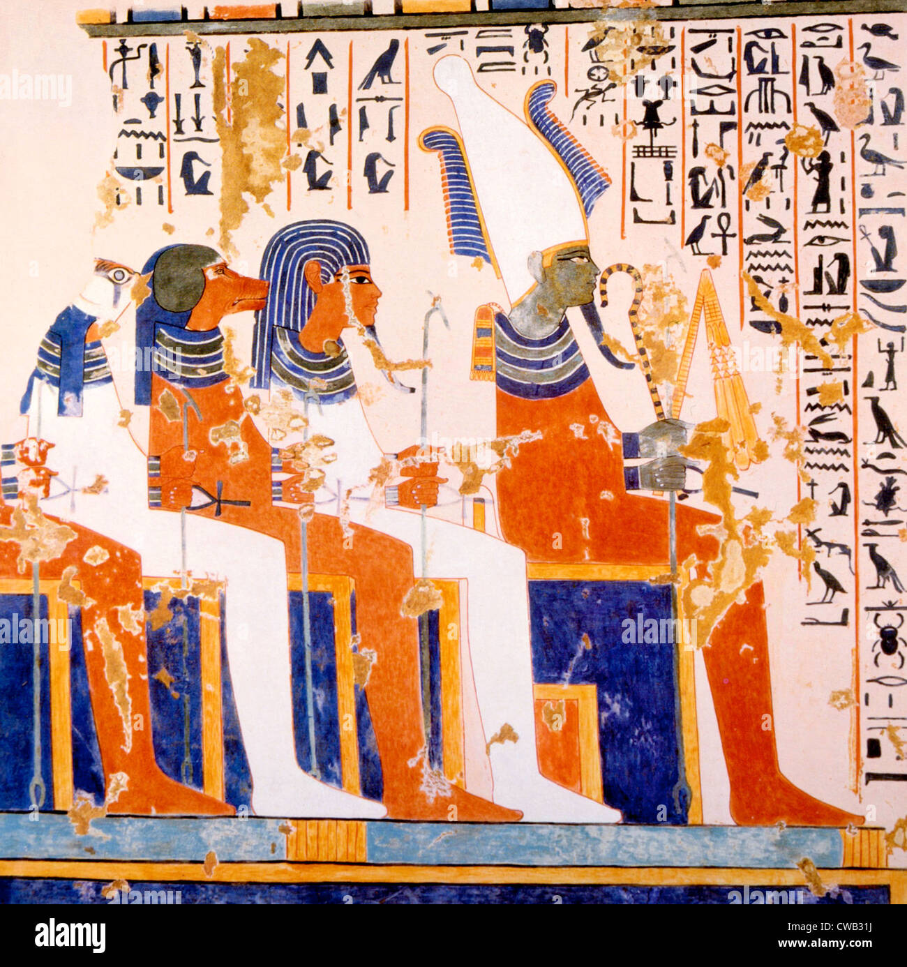 Painting of burial gods Kebehsenenuef, Hapi and Imseti with the god Isiris (right) in the tomb of Nebamun and Ipuki, - Stock Image