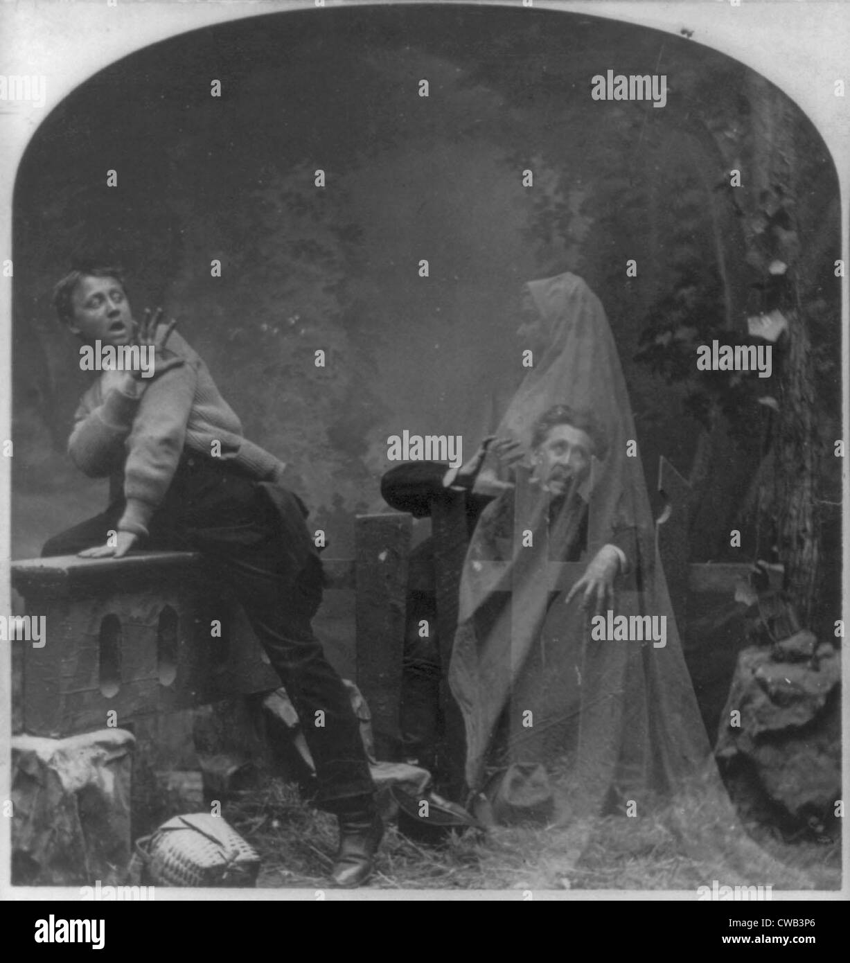 Stereograph shows a ghost scaring man and boy, a posed studio scene, original title: 'The Haunted Lane', - Stock Image