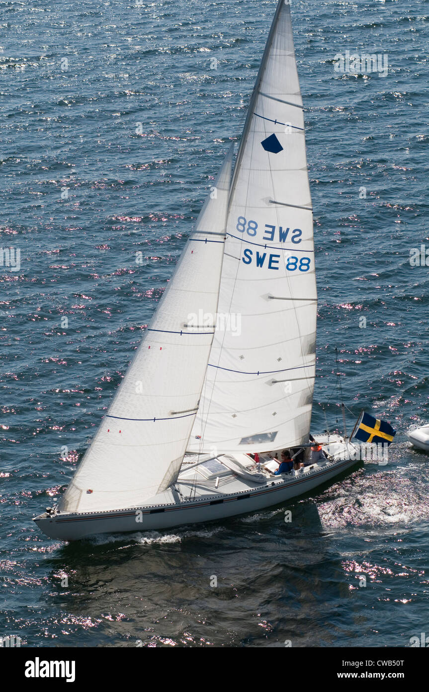 yacht yachting sweden swedish baltic sea sail sailing boat boats under sail flag wind - Stock Image