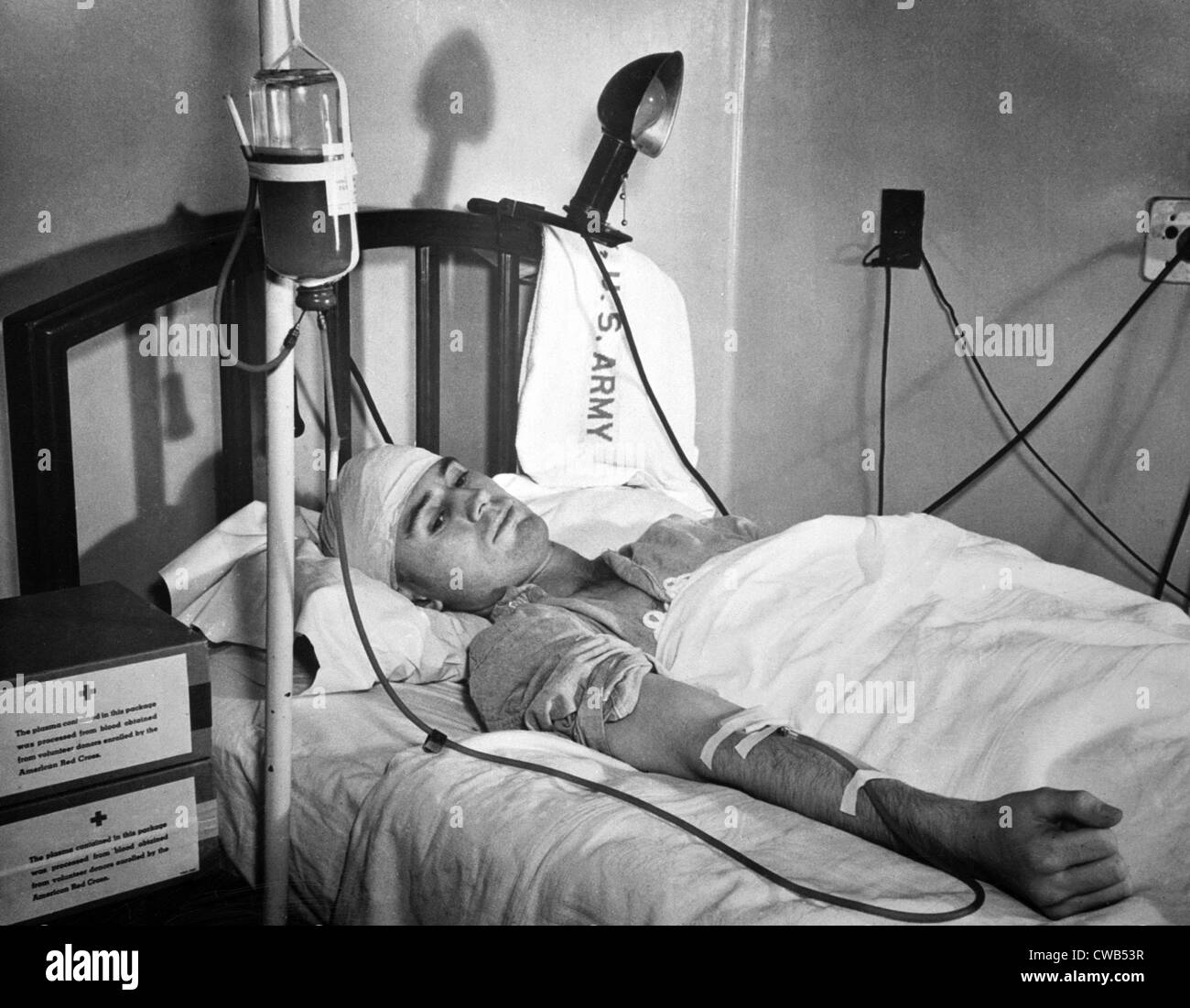 Blood Transfusion. First Lieutenant Landis D. Morris, of Olar, South Carolina, wounded by a sniper's bullet - Stock Image