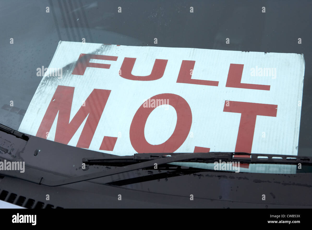 sign for full mot in the windscreen of a car for sale in northern ireland uk - Stock Image