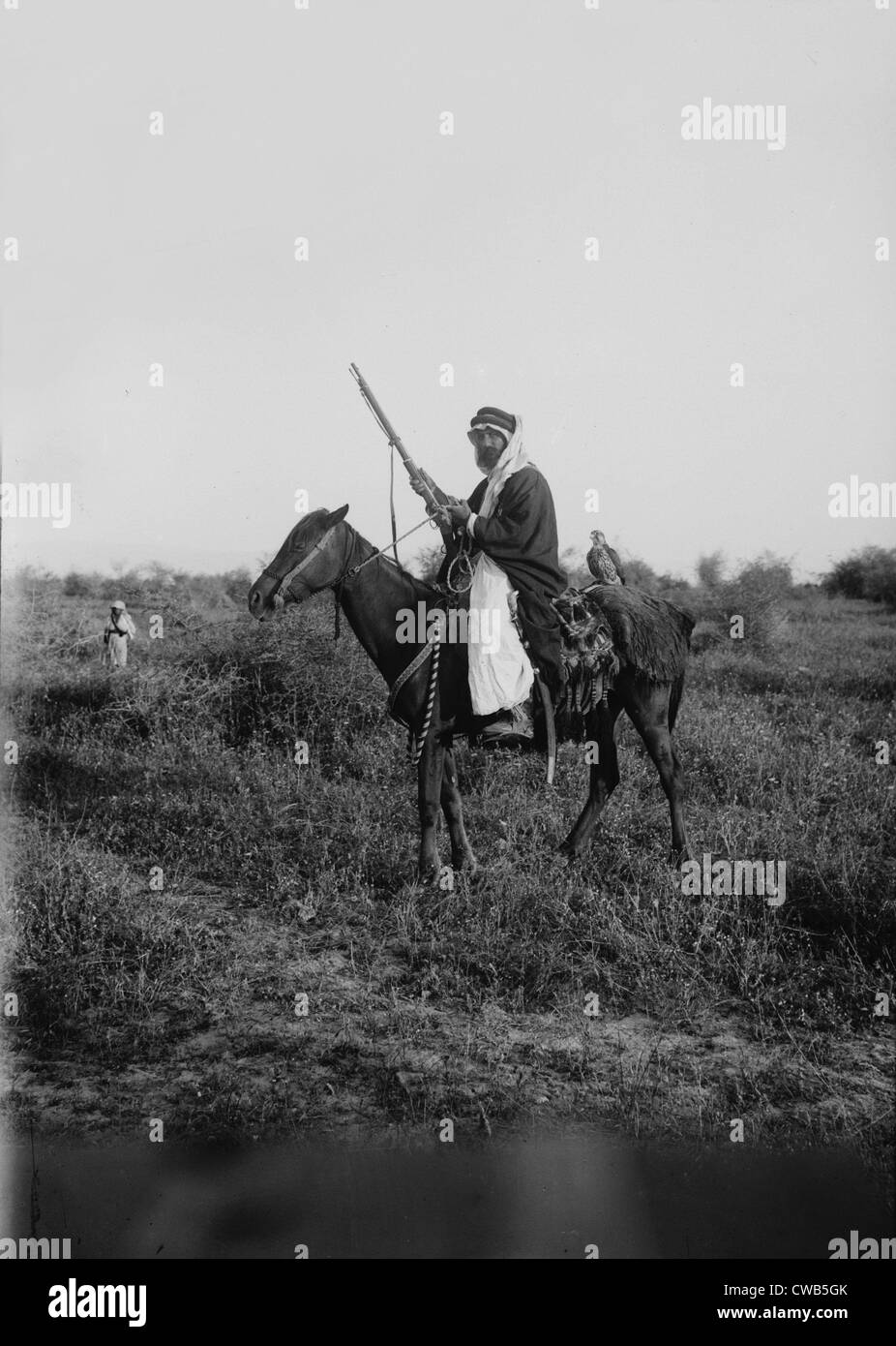 Bedouin hunter with his falcon, Jerusalem, photograph by American Colony Photo Department, 1898-1946 - Stock Image
