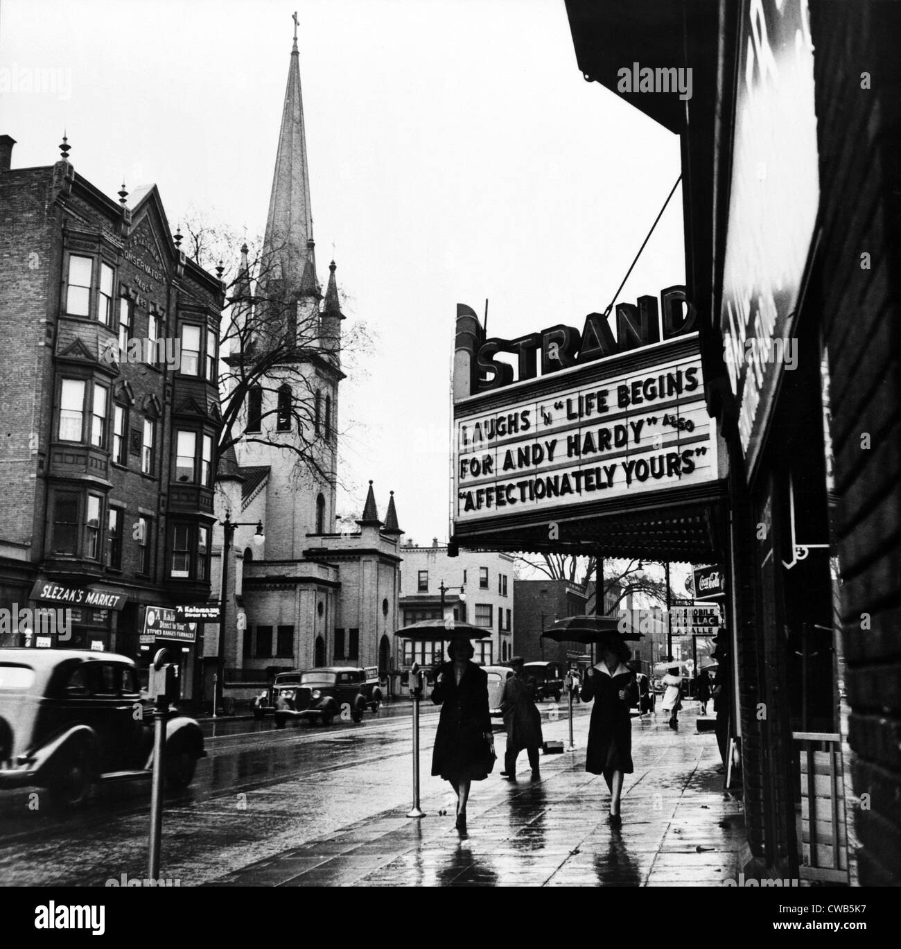 Main Street. The marquee of the Strand theater, showing LIFE BEGINS FOR HARDY, Amsterdam, New York, photograph by - Stock Image