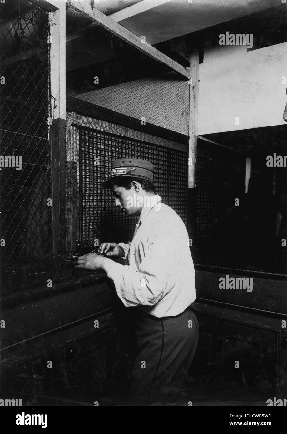A Postal Telegraph boy learning to send messages during spare moments. Main office, Broadway, New York, photograph - Stock Image