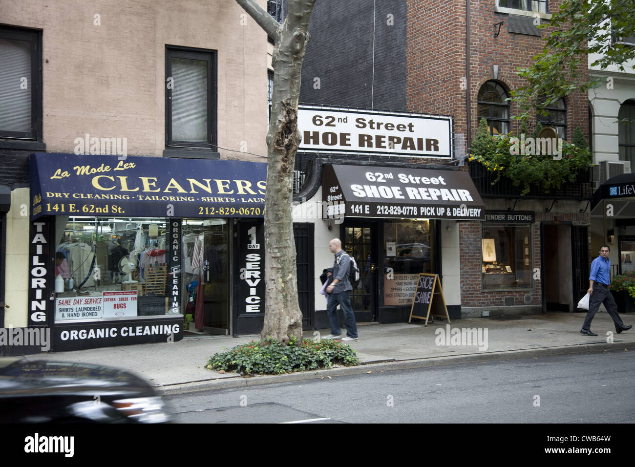 NYC is still known for its small independent shops, services & restaurants amidst this corporate world capital. - Stock Image