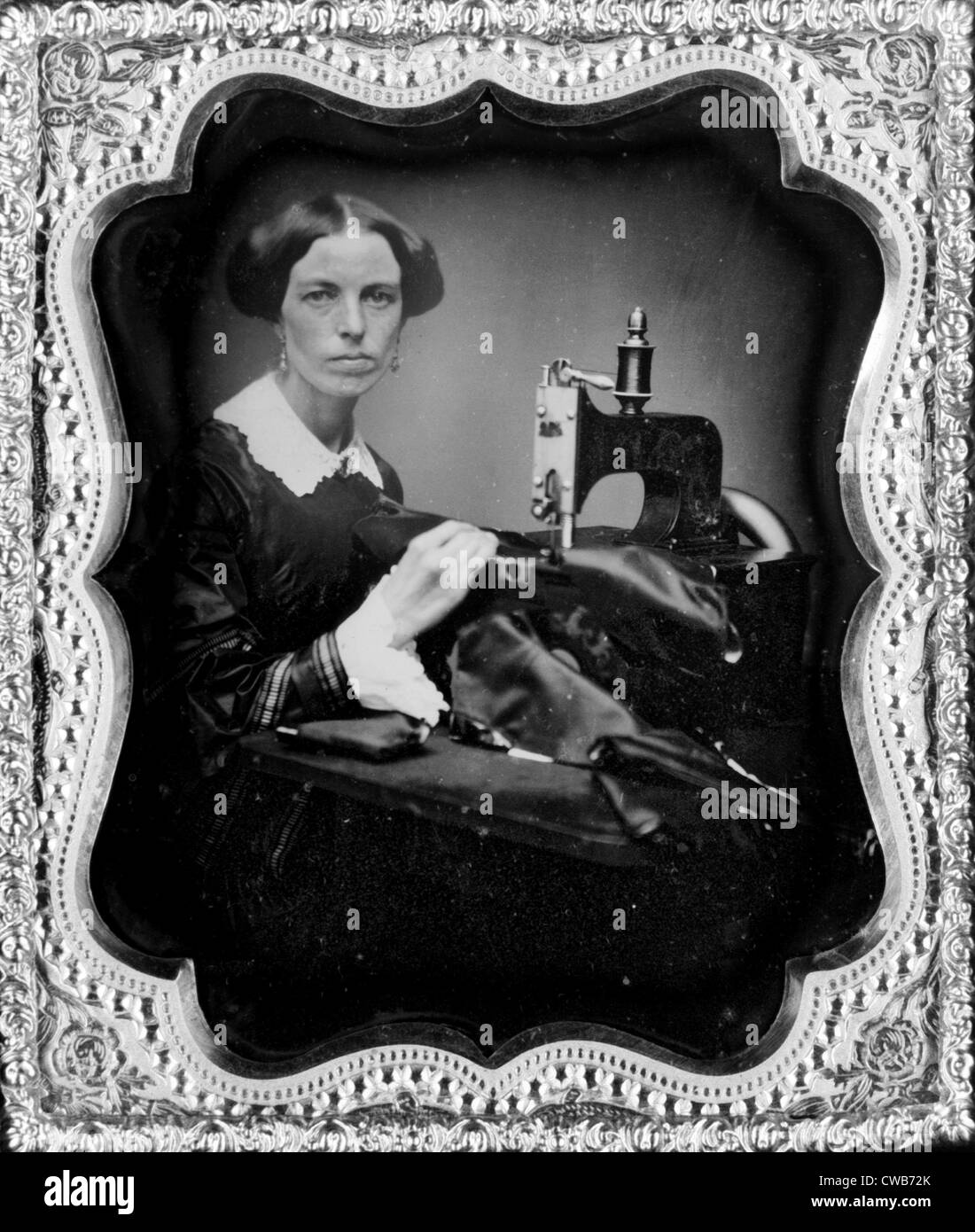Occupational portrait of a woman working at a sewing machine, sixth-plate daguerreotype, circa 1853. - Stock Image