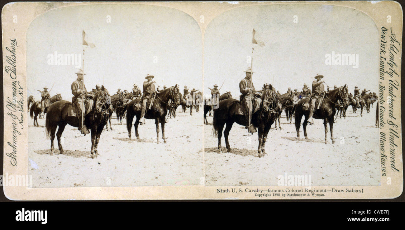 Buffalo soldiers of the Ninth U.S. Cavalry--famous Colored Regiment--Draw Sabers! stereocard ca. 1898 - Stock Image