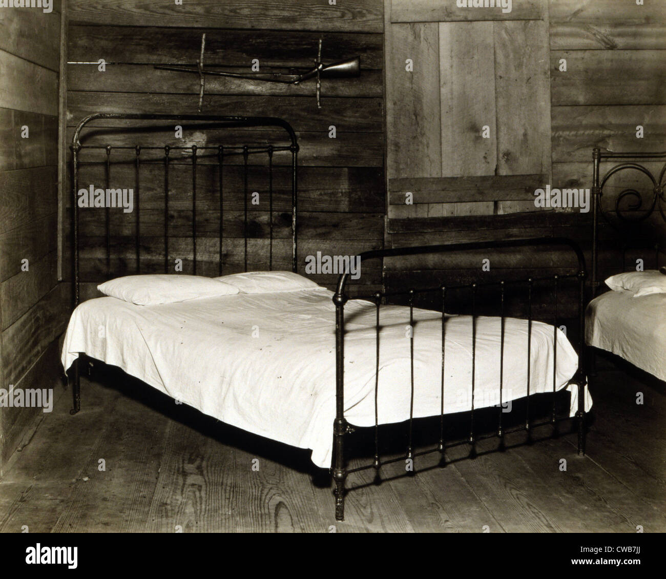 The bedroom of Floyd Burroughs, cotton sharecropper, Hale County, Alabama. Hale County, Alabama. Published in the - Stock Image