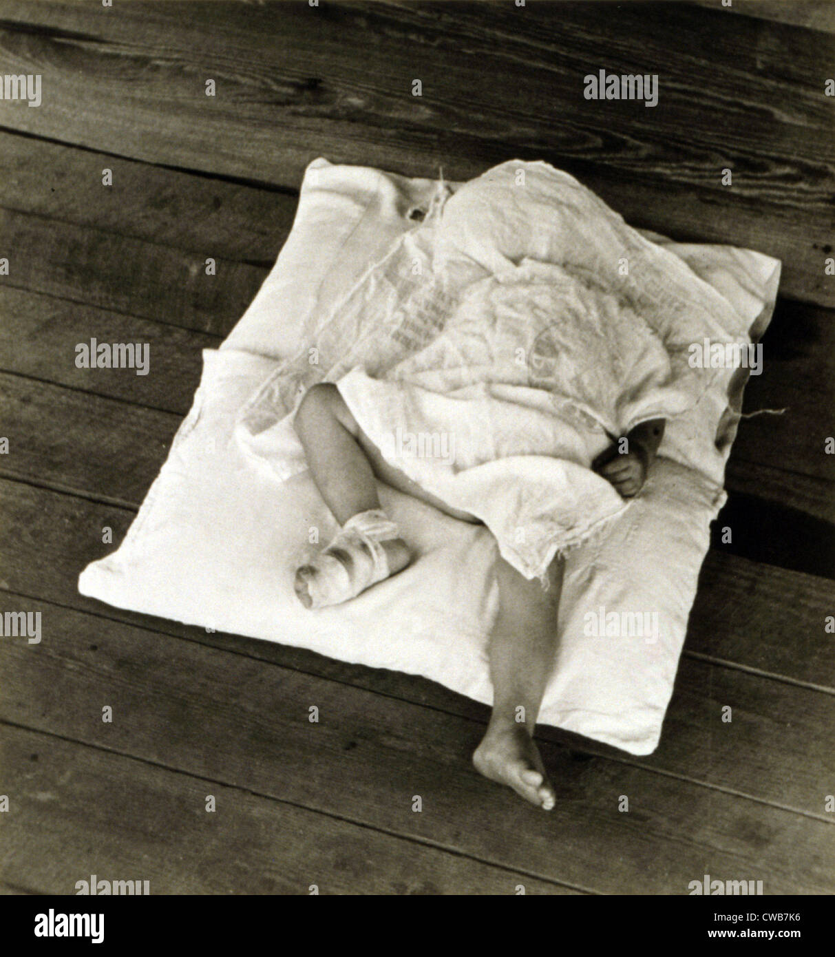 Squeakie asleep. Othel Lee, known as Squeakie, son of Floyd Burroughs, sharecropper. Hale County, Alabama. Published - Stock Image