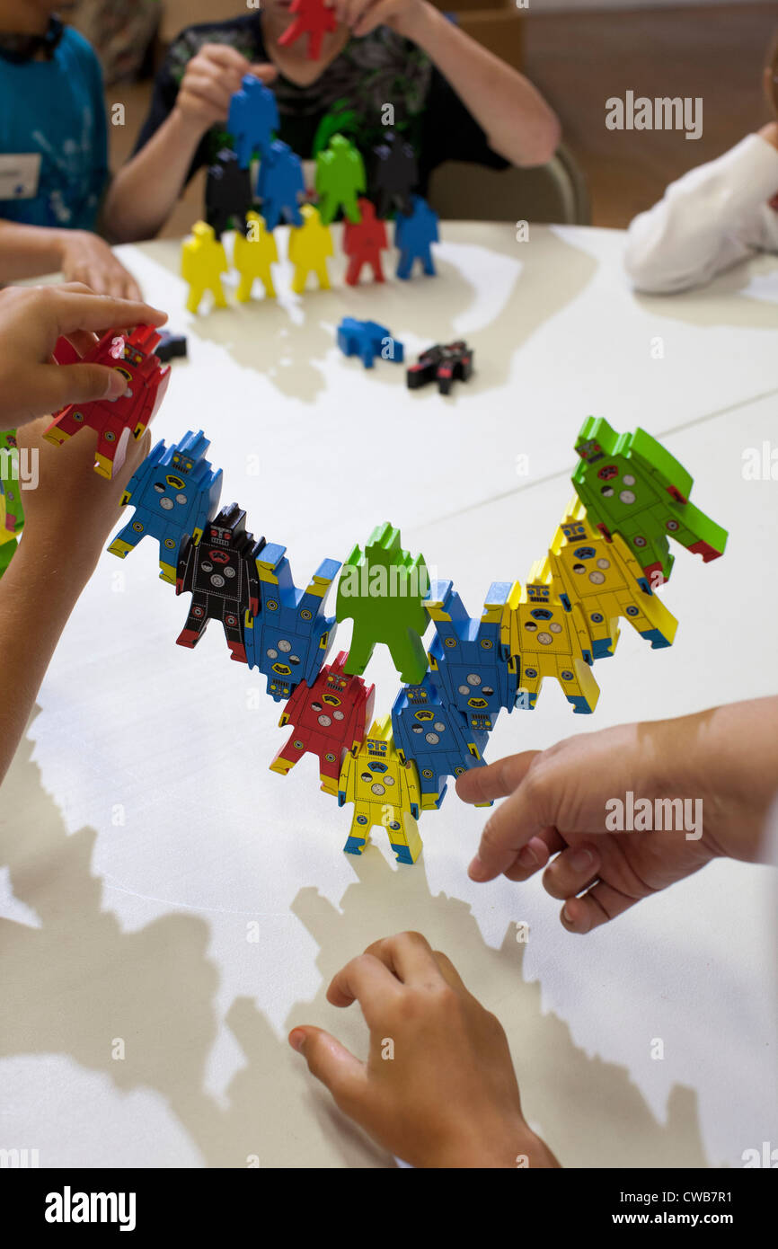 Boy builds structure that purports to show the 'instability of a government built around one person' at - Stock Image