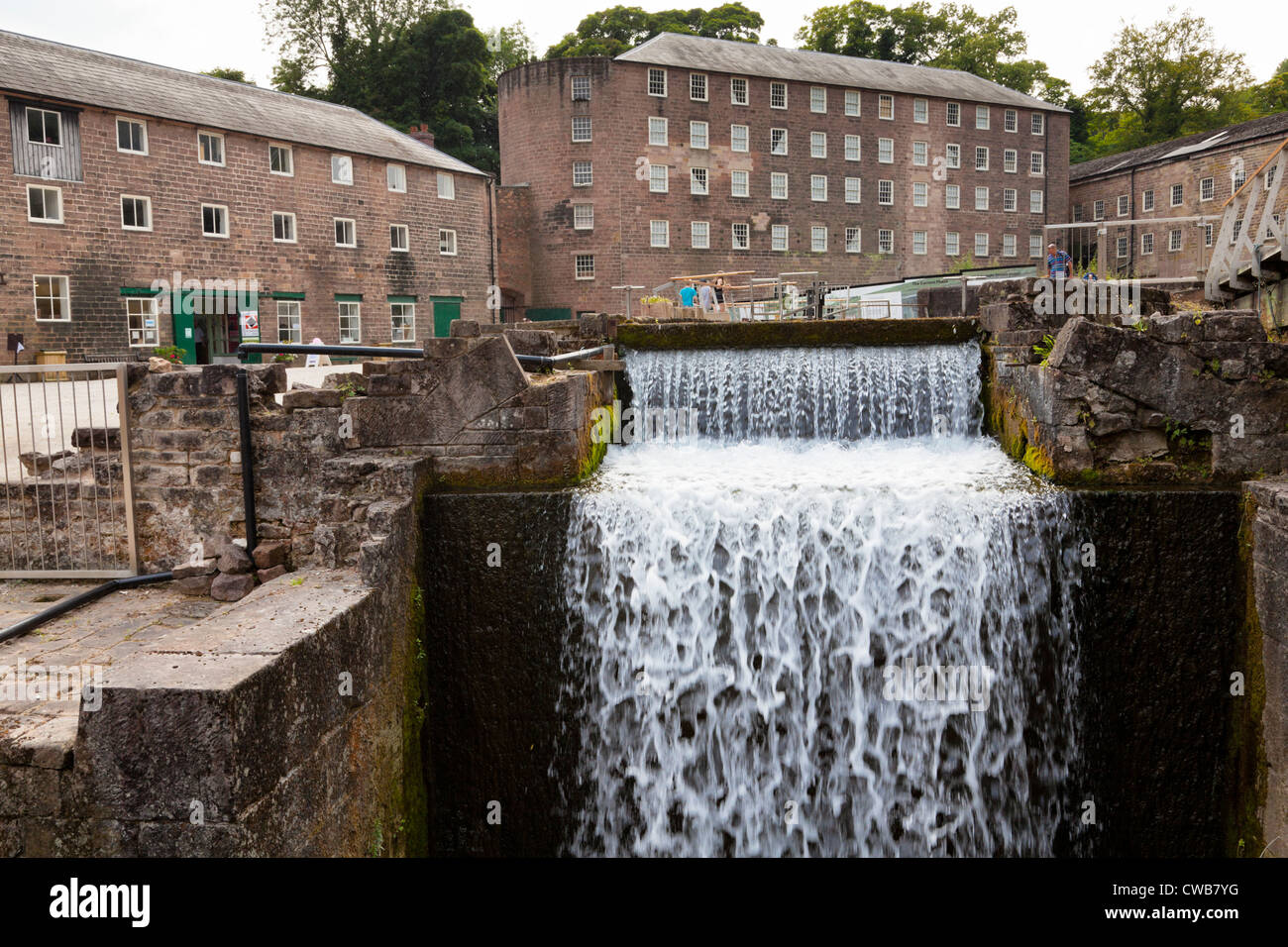 Water powered mill buildings at Cromford Mill, used for cotton spinning. Part of the Derwent Valley Mills World - Stock Image