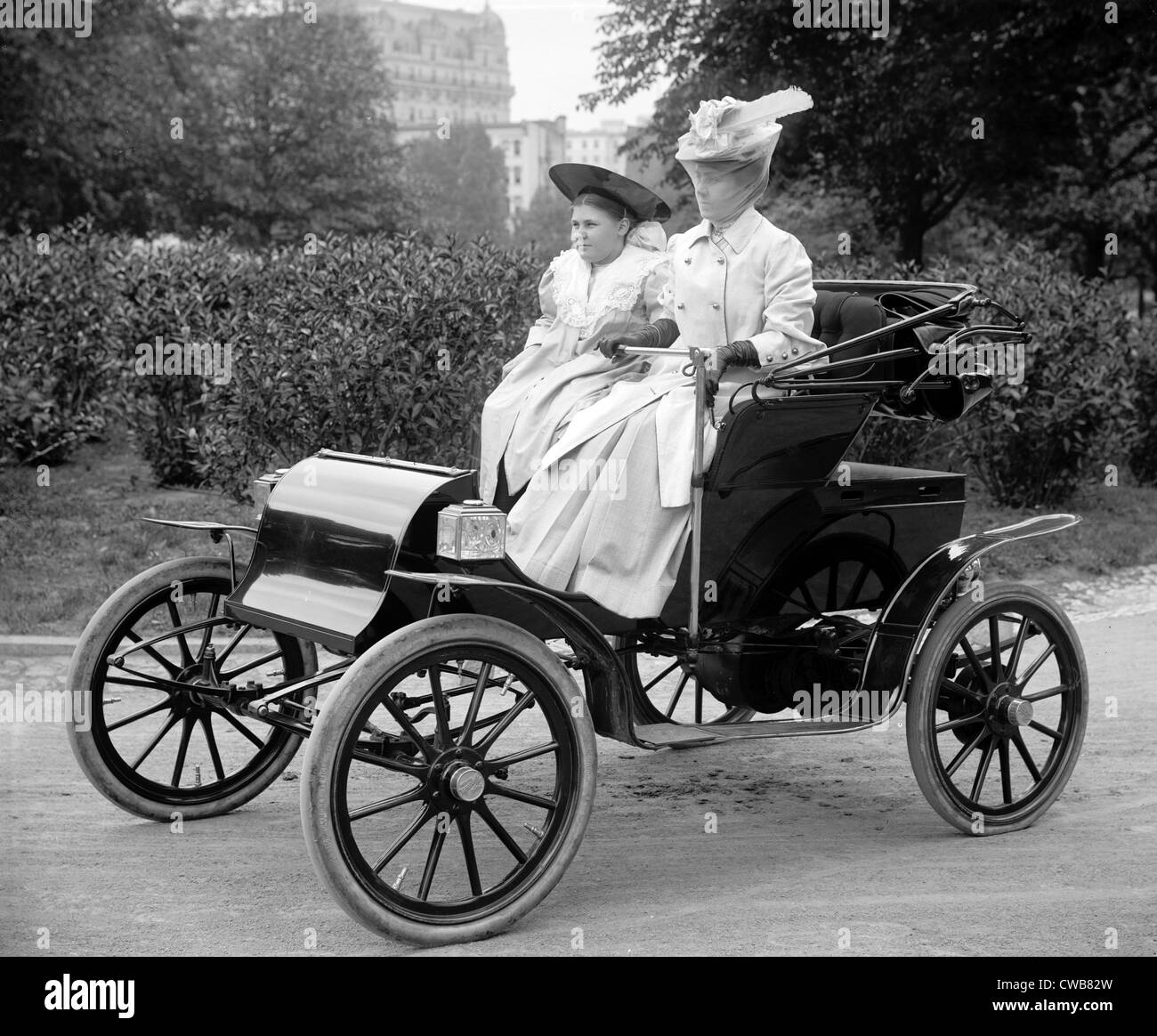 Woman driving automobile ca. 1910s. - Stock Image
