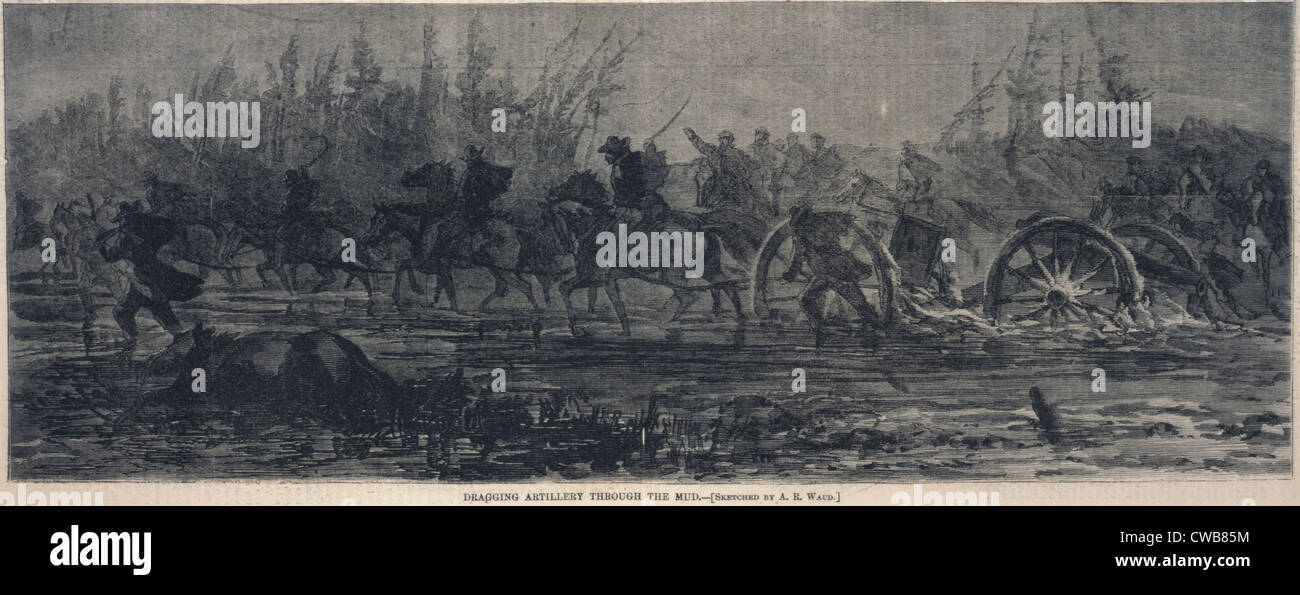 The Civil War. Dragging artillery through the mud, mounted cavalry pull artillery pieces through muddy ground. Engraving - Stock Image