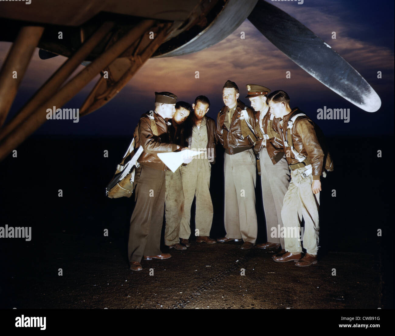 A combat crew receives final instructions just before taking off in a mighty YB-17 bomber from a bombardment squadron - Stock Image