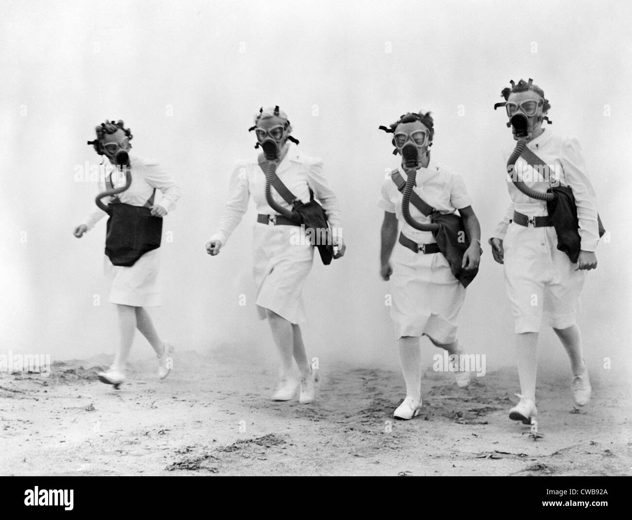 6630681ea6646 Nurses in gas masks walk through a cloud of smoke in a training drill of the