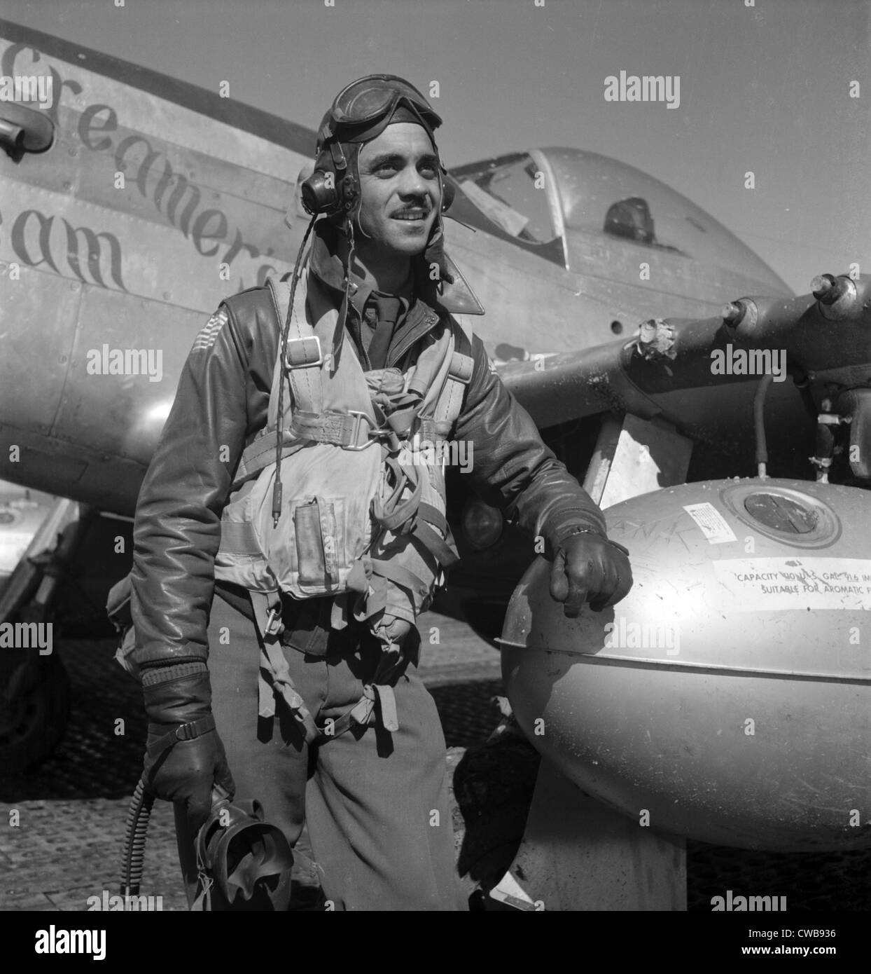 A Tuskegee fighter pilot poses with his P-51D Mustang, Ramitelli, Italy, March 1945.  Photograph by Toni Frissell. - Stock Image