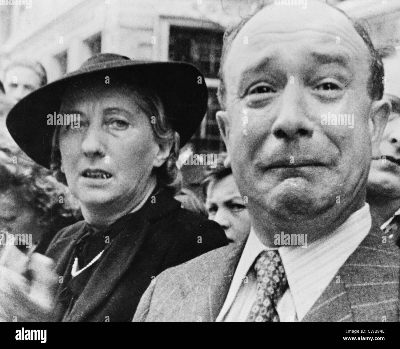 Original caption: 'A Frenchman weeps as German soldiers march into the French capital, Paris, on June 14, 1940, Stock Photo