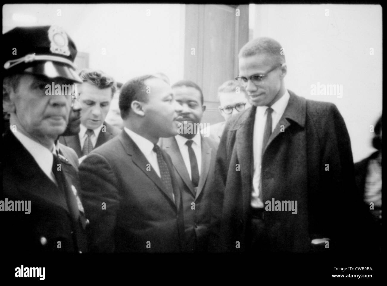 Martin Luther King Jr., and Malcolm X, waiting for press conference, 1964. - Stock Image