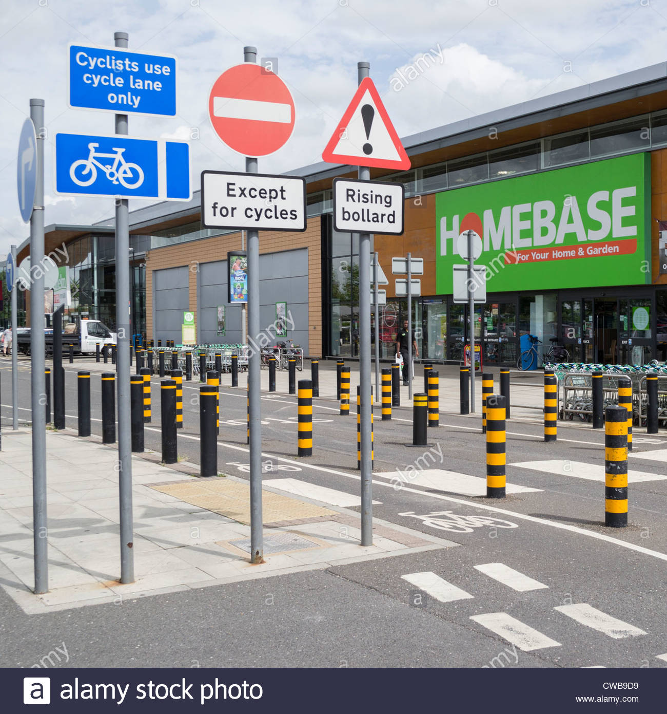 Signs and bollards at the Newmarket Road retail park in Cambridge. - Stock Image