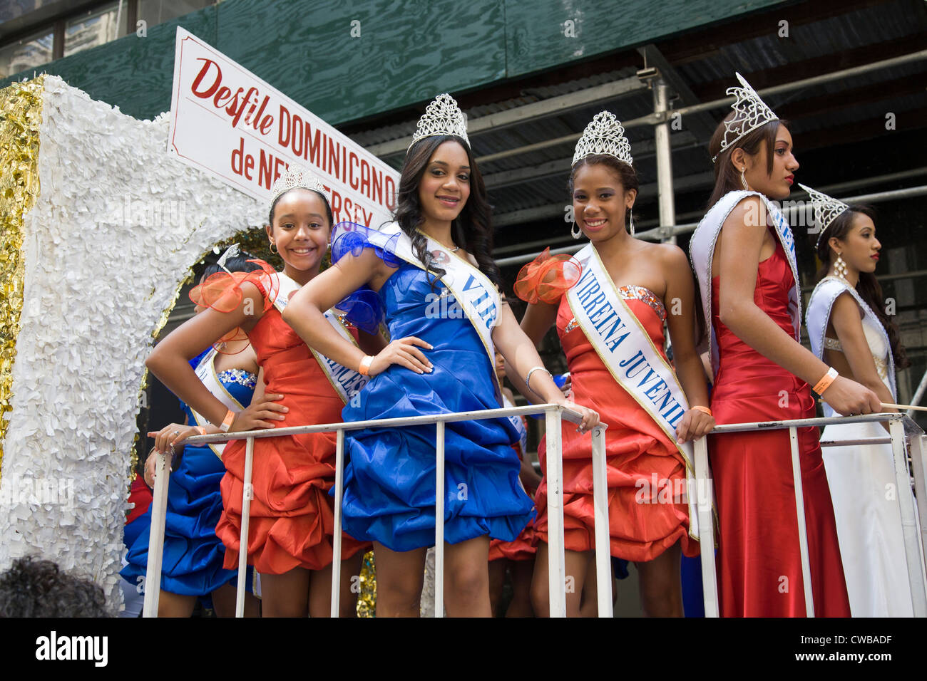 A group of young Dominican Princesses ready to ride a float up the Avenue of the Americas at the Dominican Day Parade - Stock Image