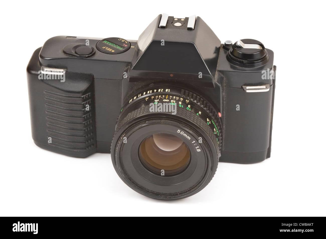 Black 35mm slr film camera on white background