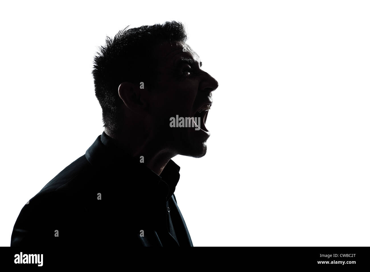 one caucasian man portrait silhouette profile screaming angry in studio isolated white background - Stock Image