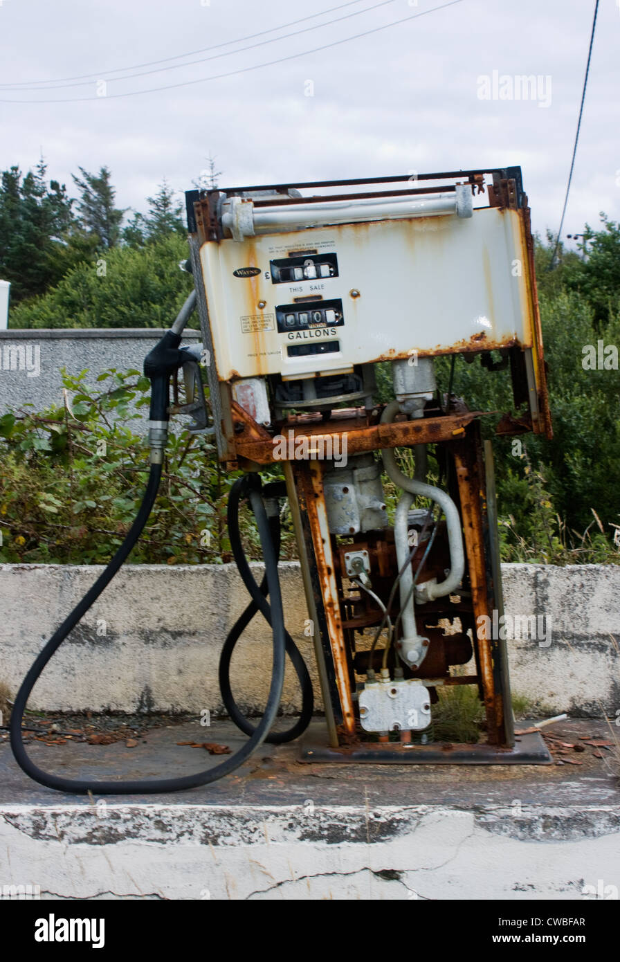 Old, rusty petrol pump at deserted filling station - Stock Image