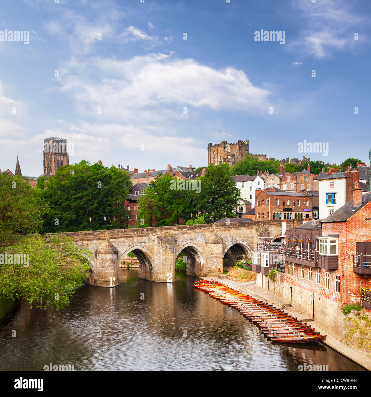 Elvet Bridge and the River Wear, Durham City, with the cathedral and castle on the skyline. - Stock Image