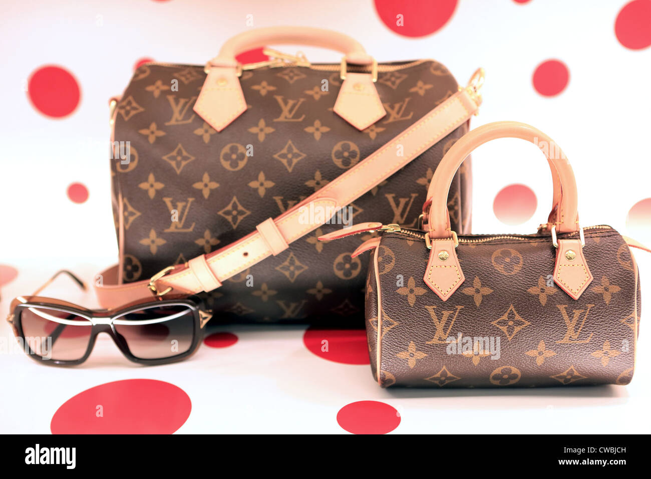 d6c80de47ee8 Louis Vuitton designer handbags and sunglasses for sale in shopping mall.