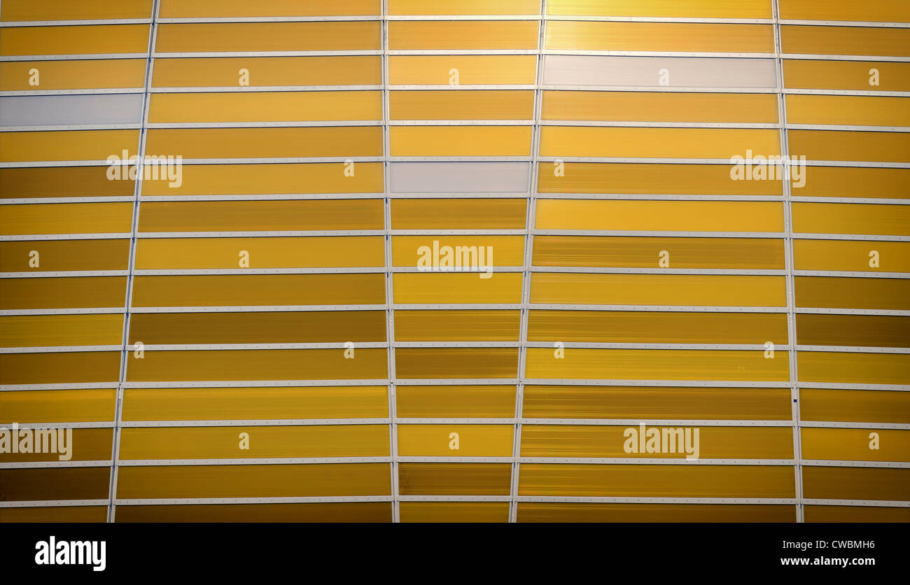 shaded amber striped background with aluminium stripes Stock Photo