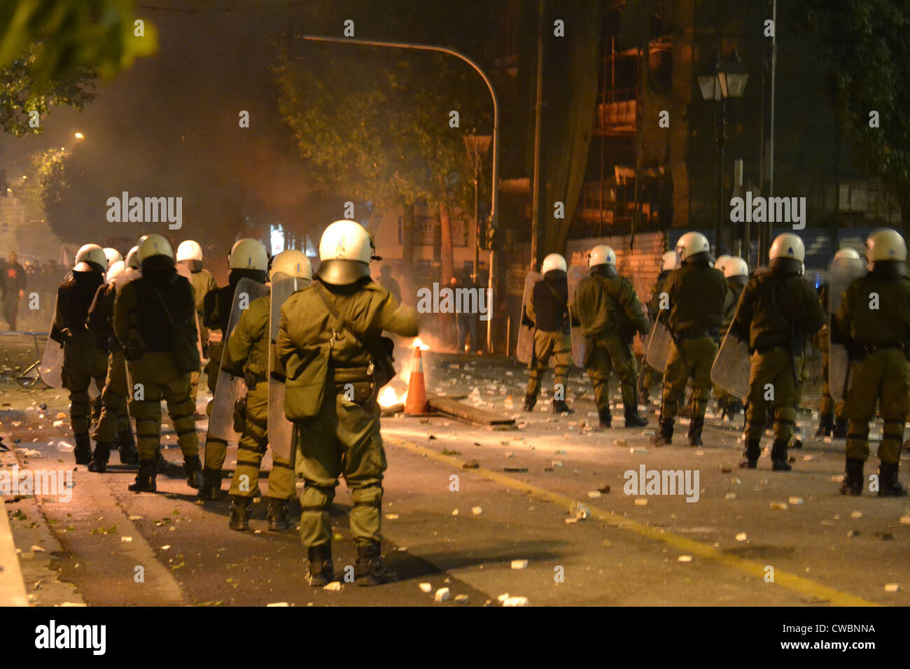 Riot police confront demonstrators during a massive anti austerity rally with serious clashes. - Stock Image