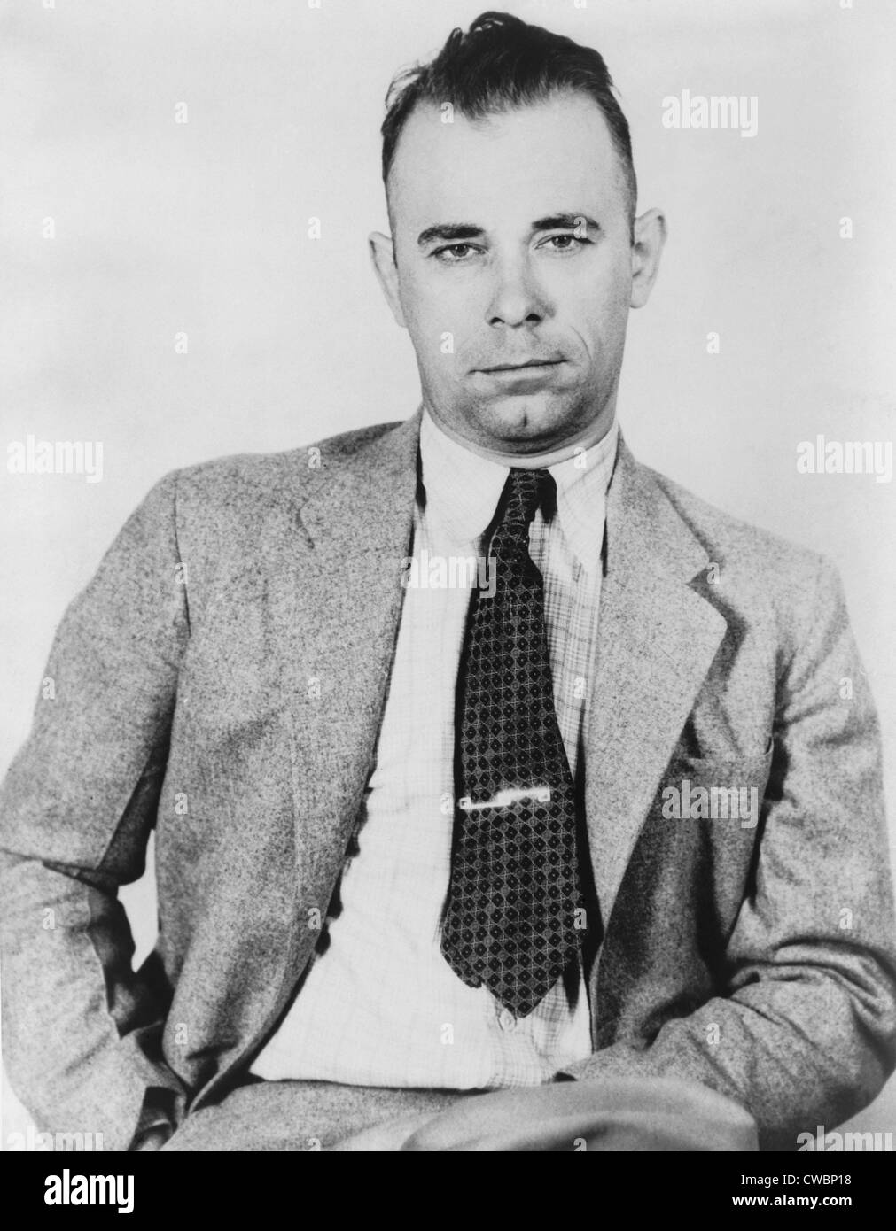 John Dillinger (1903-1934), famous bank robber, in police custody in September 1933, would soon be freed by five - Stock Image
