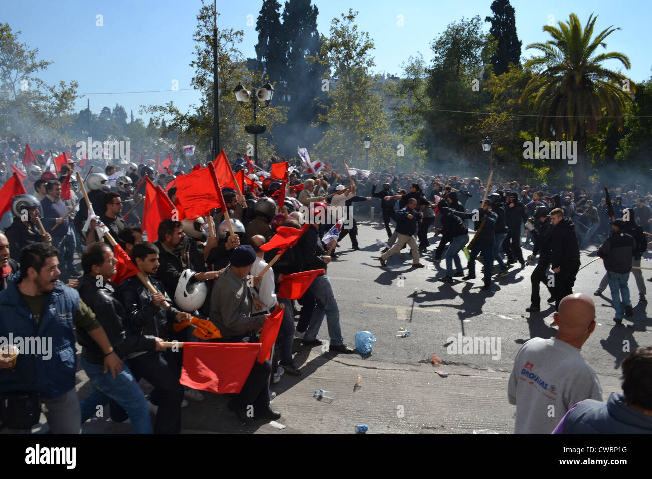 Anarchists clash with communists during a general anti-austerity strike in Athens. - Stock Image