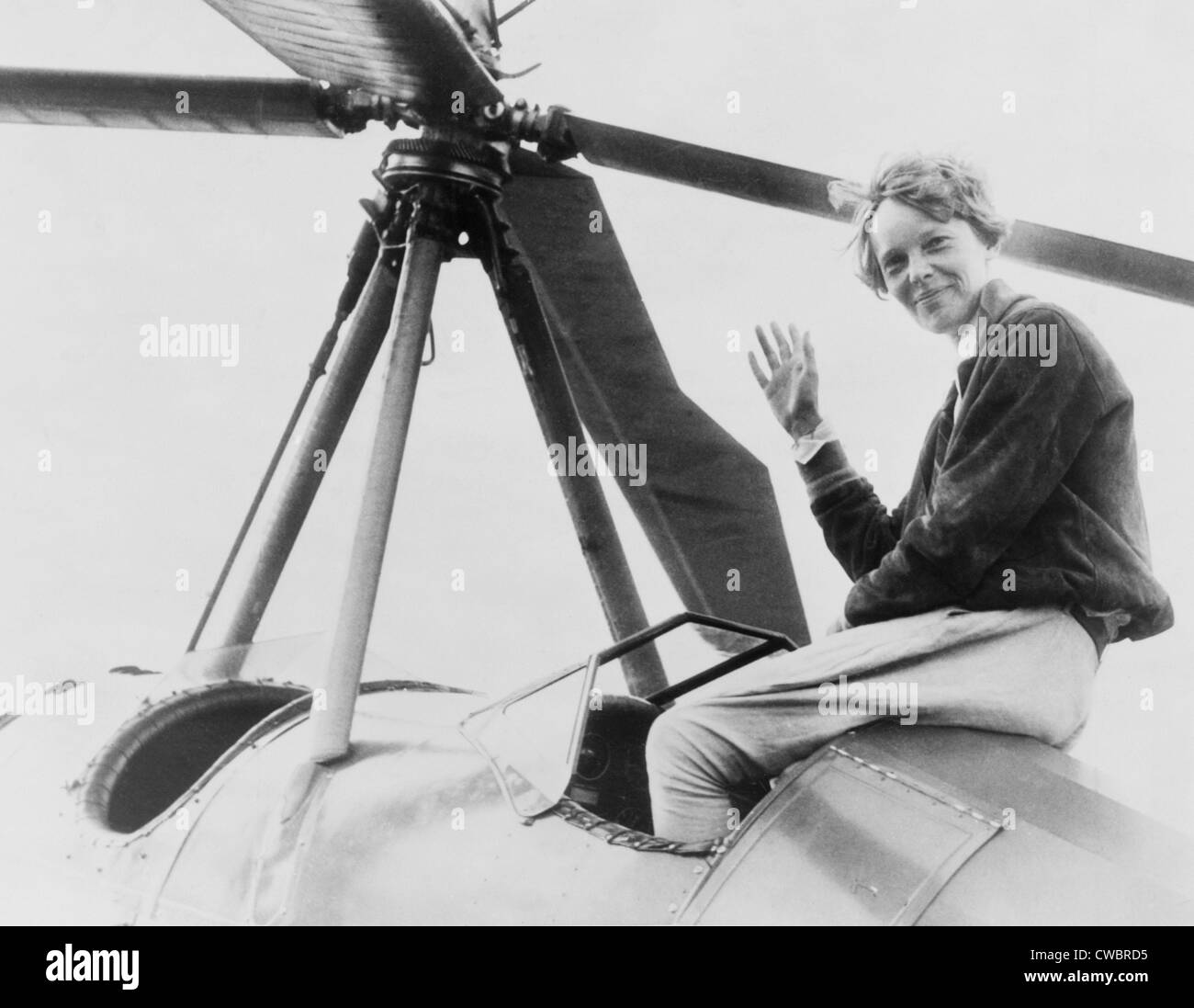Amelia Earhart (1897-1937), waving, seated outside cockpit on top of an Autogiro, in Los Angeles, shortly after - Stock Image