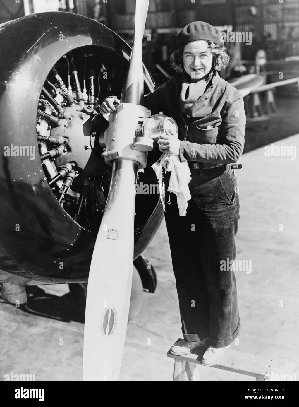 Laura Ingalls (1901-1967), American female aviator atop ladder maintaining an airplane propeller. In 1934 she completed - Stock Image