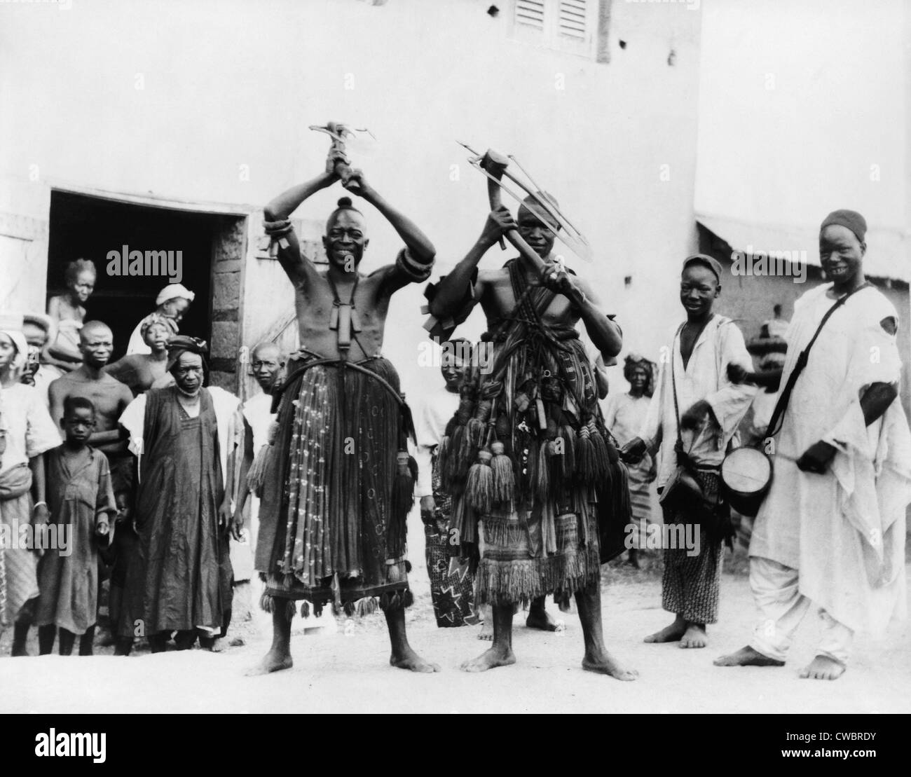 Two itinerant medicine men on a street in the village of Abeokuta, Southern Nigeria. Performing a 'hoe dance' - Stock Image