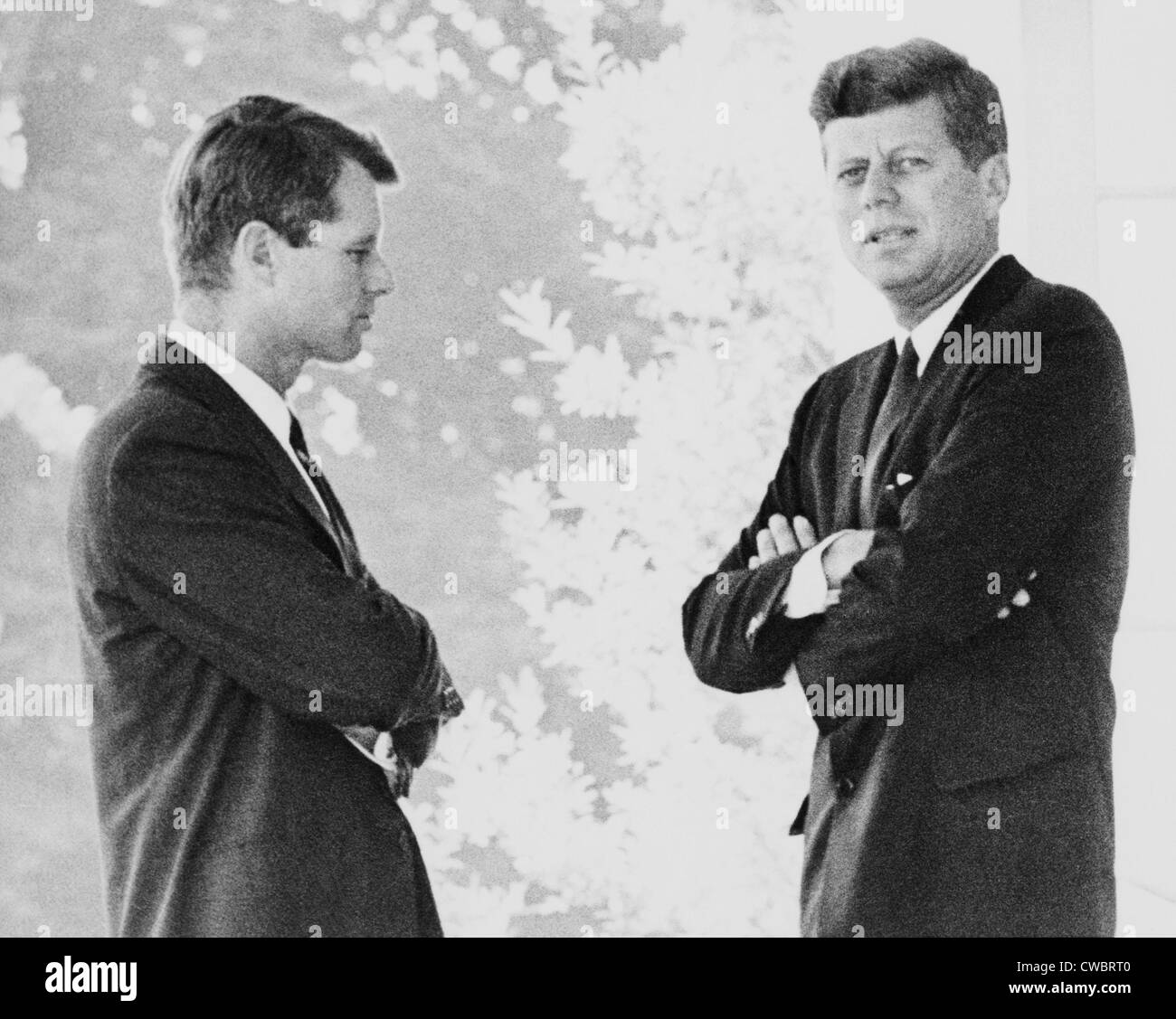 Brothers Robert F. and John F. Kennedy, portrait, standing on the White House portico. Ca. 1962. - Stock Image
