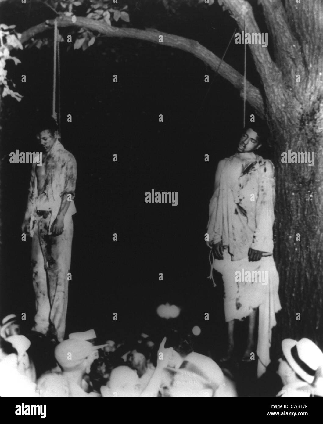 Two lynched African American men, hanging from tree in Marion, Indiana. Ca. 1930s. - Stock Image